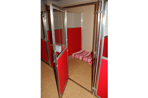 kennels for dogs. very large and comfortable, doors are colored red